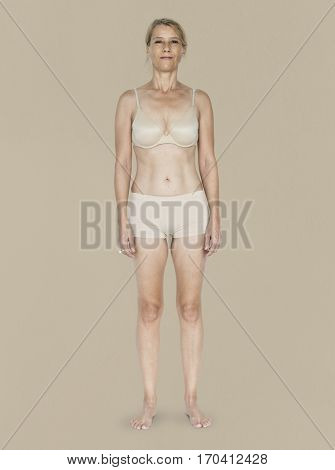 Caucasian Blonde Female Model On Brown Background