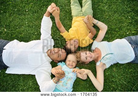 Lying Family On Grass