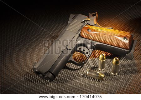 Semi automatic handgun with cartridges and orange lighting