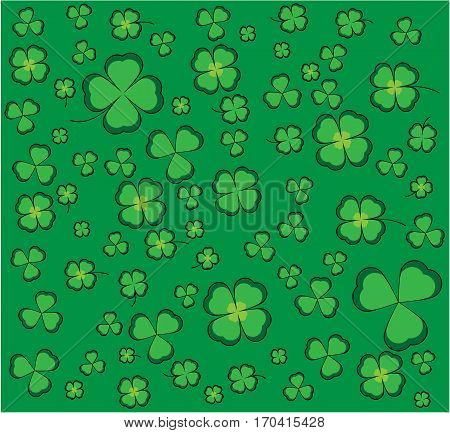 Clover background with green shamrocks and four-leaf clovers for luck