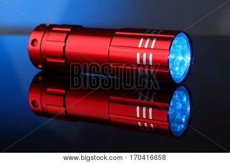 Pocket LED small lamp of red color with reflection