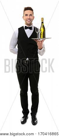 Handsome young waiter with champagne and glasses on white background