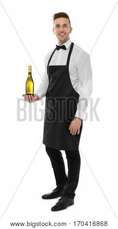 Handsome young waiter with bottle of champagne on white background
