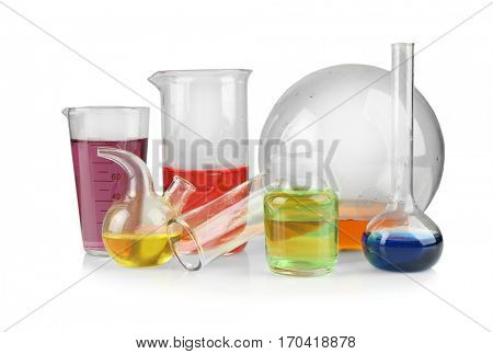 Different chemical glassware with color water on white background