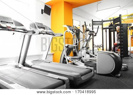 Treadmills in a row in a gym