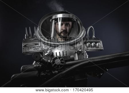 Robotic, Technology, Space man, astronaut dressed in silver or metalized space suit. Armed with a laser gun and surrounded by smoke