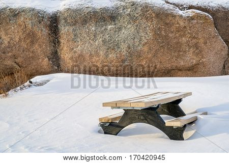 picnic table and granite rock in Vedauwoo Recreation Area, Wyoming,  known to the Arapaho Indians as Land of the Earthborn Spirit, winter scenery