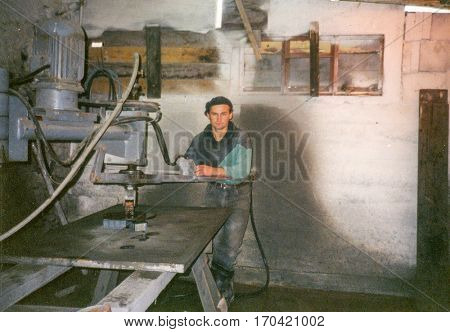 PIESZYCE, POLAND, CIRCA 1960's: Vintage photo of a worker in stone factory