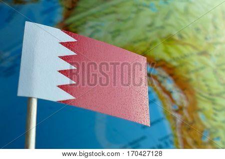 Bahraini Flag With A Globe Map As A Background Macro