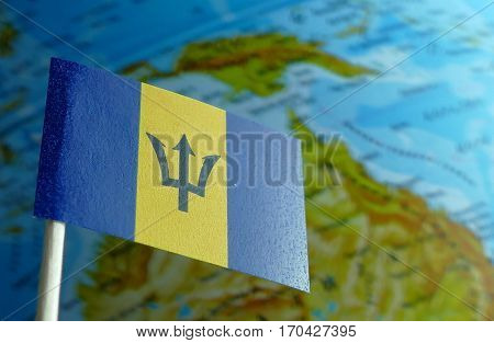 Barbados Flag With A Globe Map As A Background Macro