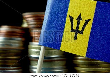 Barbados Flag Waving With Stack Of Money Coins Macro