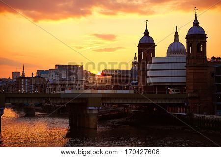 London Bridge sunset at Thames with St Paul Pauls Cathedral