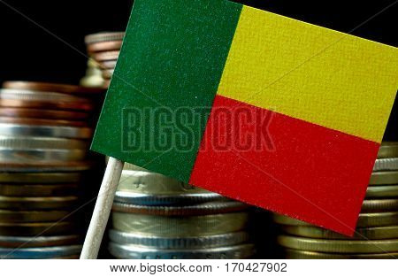 Benin Flag Waving With Stack Of Money Coins Macro
