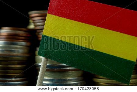 Bolivian Flag Waving With Stack Of Money Coins Macro