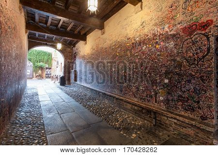 VERONA ITALY- September 08 2016: The wall full of messages on different foreign languages from lovers in Juliet house in Verona.