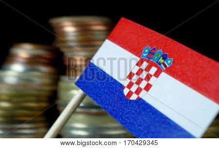Croatian Flag Waving With Stack Of Money Coins Macro