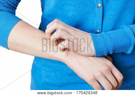 Close Up Of Woman Scratching Her Arm