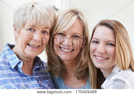 Smiling Female Multi Generation Portrait At Home