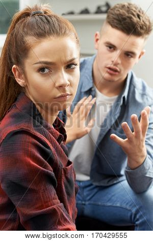 Teenage Couple Having Relationship Difficulties At Home
