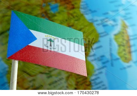 Equatorial Guinea Flag With A Globe Map As A Background Macro