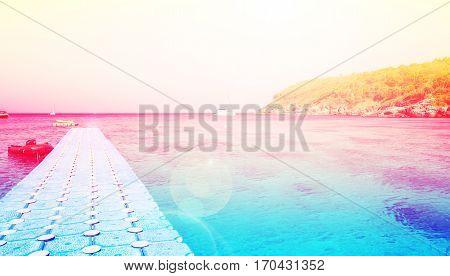 Footbridge leading to the jetty on beautiful island