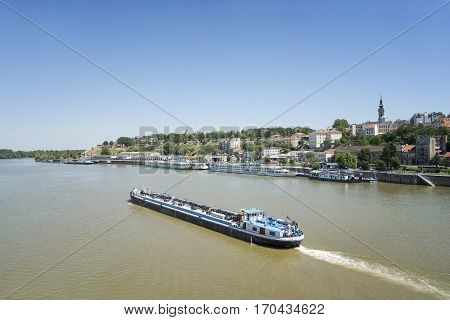 BELGRADE, SERBIA, JULY 4, 2014: An oil tanker passing through Sava river, Belgrade, Serbia.