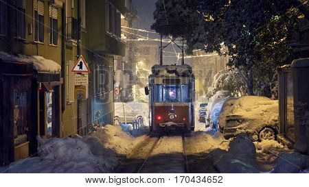 ISTANBUL, TURKEY, JANUARY 9, 2017: Historic tram of Moda working under heavy snow at Kadikoy, Istanbul, Turkey.