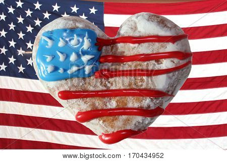 American Flag Donut. Heart shaped donut with American flag frosting in Red White and Blue.