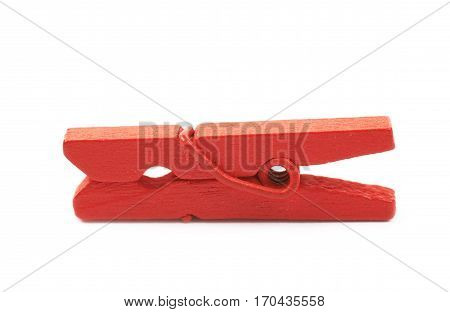 Single red painted wooden clothespin isolated over the white background