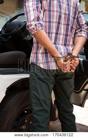 Man handcuffed behind his back for drinking and driving