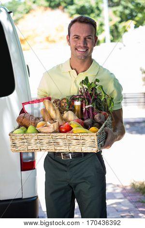 Happy man delivering online grocery order