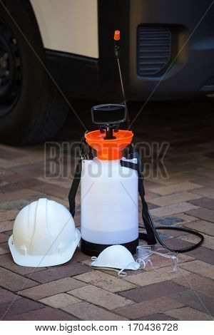 Insecticide sprayer on pavement