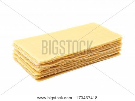Pile of dried lasagna pasta sheets isolated over the white background