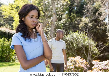 Young couple after having fight ignoring each other in the park