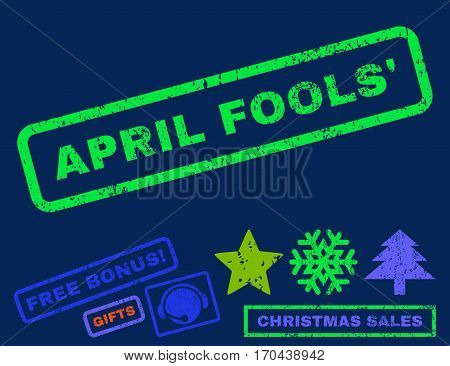April Fools text rubber seal stamp watermark with bonus christmas symbols. Caption inside rectangular shape with grunge design and scratched texture.