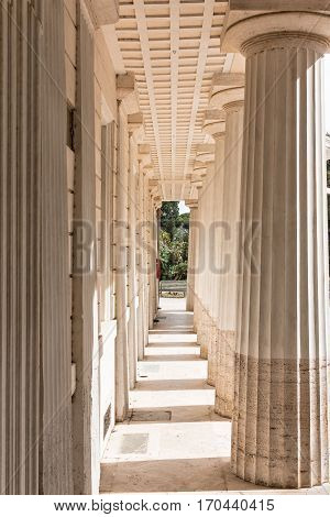 a colonnade perspective in light of sun