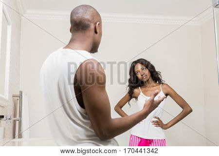 Young couple into an argument in the bathroom