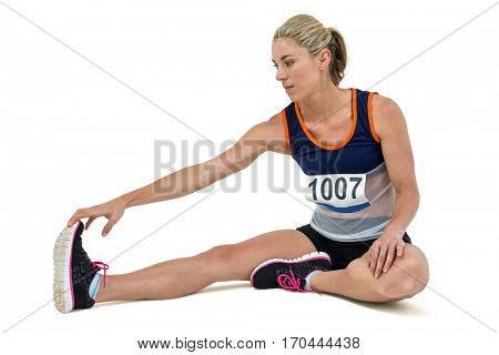 Athletic woman stretching her hamstring on white background