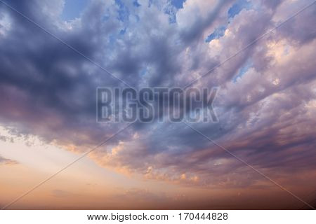 Dramatic colorful cloudscape, evening sky background texture with different types of clouds