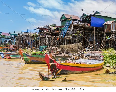 Boats and stilt houses in Kampong Phluk floating village, Tonle Sap lake, Siem Reap Province, Cambodia