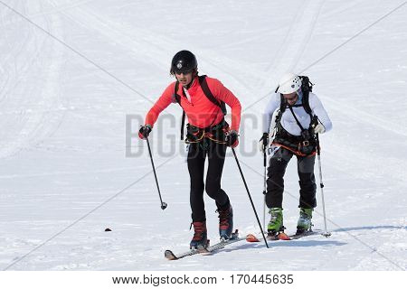 AVACHA VOLCANO KAMCHATKA PENINSULA RUSSIA - APRIL 21 2012: Open Cup of Russia on Ski-Mountaineering on Kamchatka - team ski mountaineers climb on mountain on skis strapped to climbing skins.