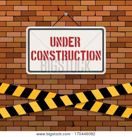 Simple white sign with text 'Under Construction' hanging on a red brick wall with warning tapes. Grunge brickwork background. Building engineering concept. Creative template for web design