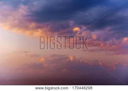 Romantic fantastic colorful clouds evening sky texture with different types of clouds at sunset.