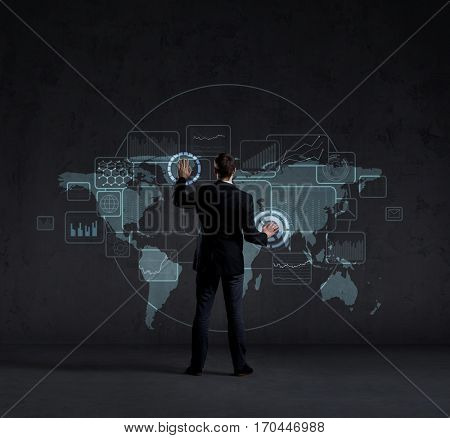Businessman standing over futuristic map background. Business, technology, future, globalization concept.