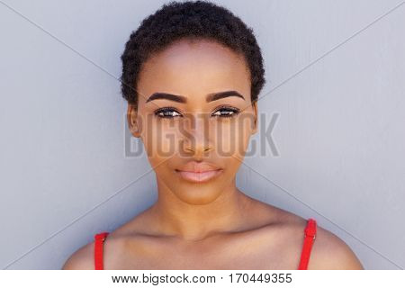 Young African American Woman Against Gray Wall Staring