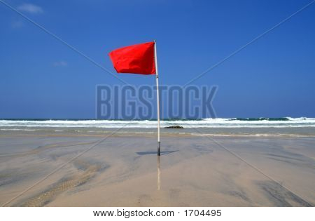 A Red Dangerous Swimming Warning Lifeguard Flag.