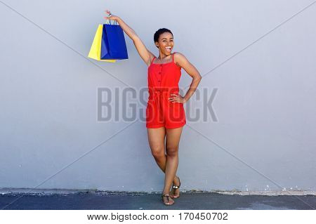 Happy African American Woman Holding Shopping Bags