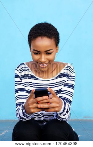 Attractive Young Black Woman Sitting With Cell Phone