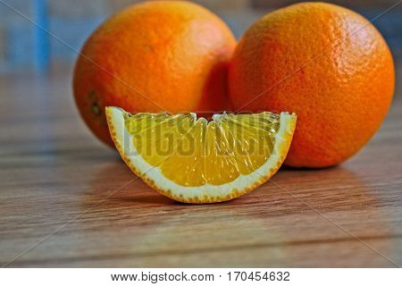 Closeup of oranges on a wooden table