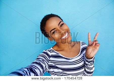 Cool Young Black Woman Taking Selfie With Peace Hand Sign